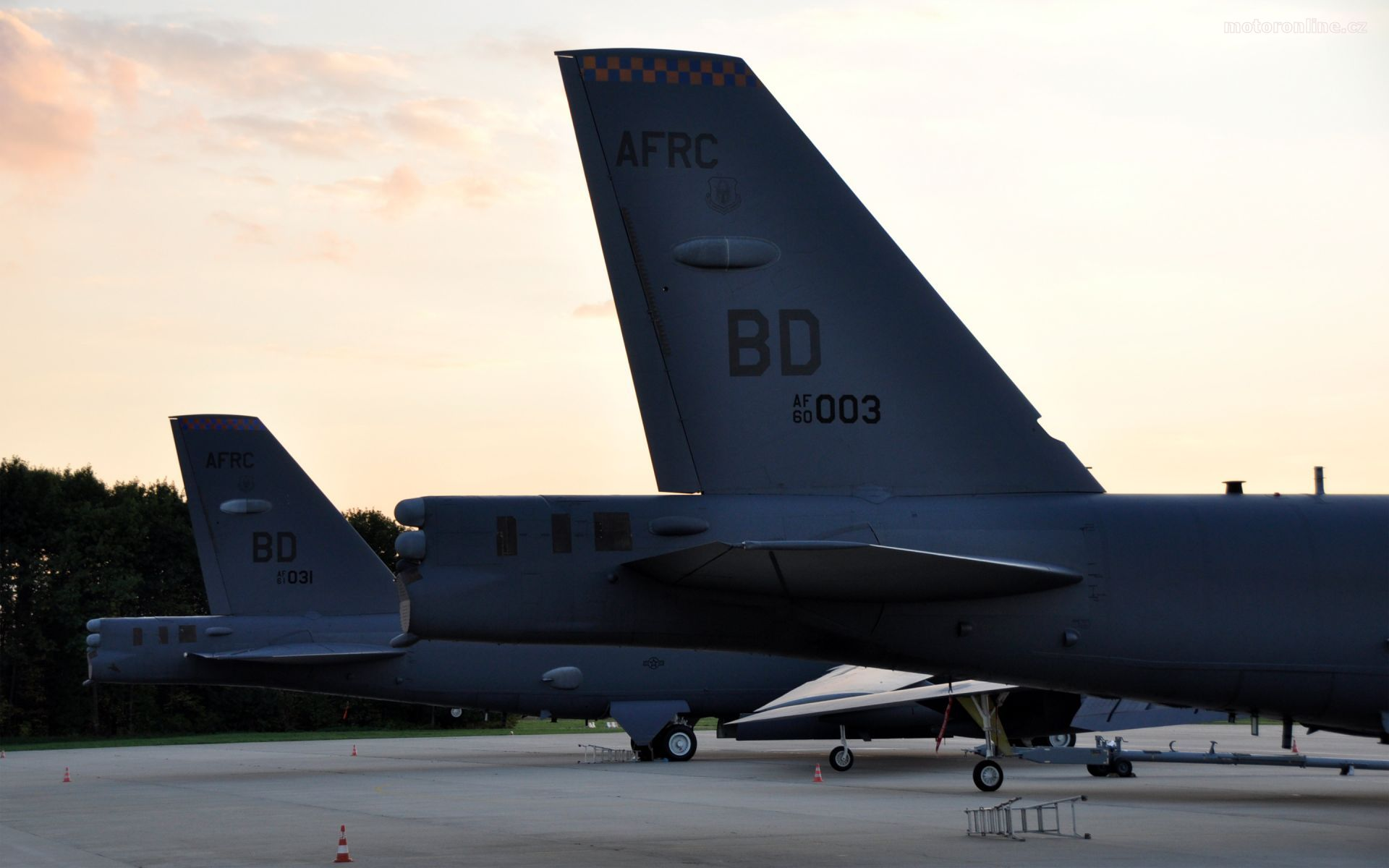 Two Bombers B 52H Stratofortress sunset tail detail